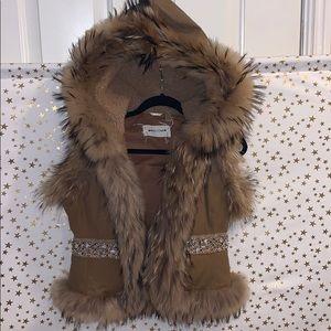 Fur vest with rhinestone detail. Real fur.